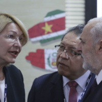 """Venezuela's Chief Prosecutor Luisa Ortega Diaz, left, talks with their counterparts in Mercosur during a meeting of Mercosur trade bloc prosecutors,  in Brasilia, Brazil, Wednesday, Aug. 23, 2017. Brazil's attorney general is sharply criticizing the recent ouster of his counterpart in Venezuela. Attorney General Rodrigo Janot said Wednesday that the removal of Venezuelan chief prosecutor Luisa Ortega Diaz was """"an institutional rape"""" and that it eroded the independence of Venezuela's justice system. (AP Photo/Eraldo Peres)"""