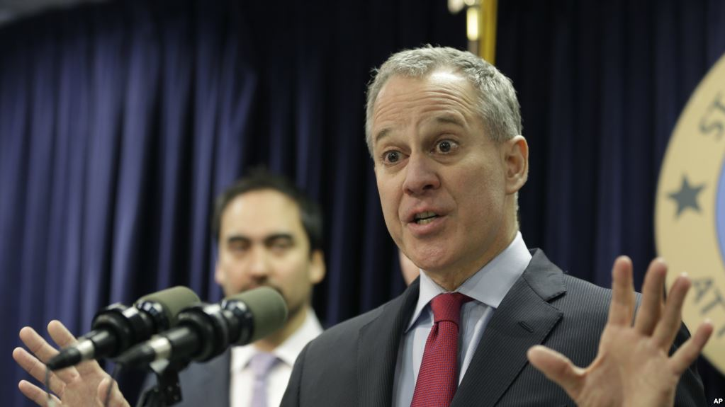 FILE- In this March 21, 2016 file photo, New York Attorney General Eric Schneiderman. Two weeks after officials in two dozen states asked Donald Trump to kill one of President Barack Obama's plans to curb global warming, Schneiderman was lead author on a rebuttal letter signed by Democratic attorneys general in 15 states, plus four cities and counties, asking the president-elect to save it. (AP Photo/Seth Wenig, File)