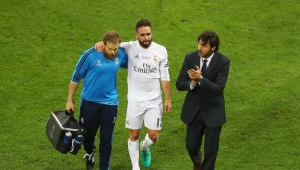 MILAN, ITALY - MAY 28:  Dani Carvajal of Real Madrid is is lead of the pitch as he substituted after getting injured during the UEFA Champions League Final match between Real Madrid and Club Atletico de Madrid at Stadio Giuseppe Meazza on May 28, 2016 in Milan, Italy.  (Photo by Clive Mason/Getty Images)
