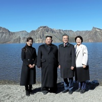 MOUNT PAEKTU, NORTH KOREA - SEPTEMBER 20: (EDITORIAL USE ONLY, NO COMMERCIAL USE) North Korean leader Kim Jong Un (2nd L) and his wife Ri Sol Ju (L) pose with South Korean President Moon Jae-in (2nd R) and his wife Kim Jung-sook (R) on the top of Mount Paektu on September 20, 2018 in Mount Paektu, North Korea. Kim and Moon meet for the Inter-Korean summit talks after the 1945 division of the peninsula, where they will discuss ways to denuclearize the Korean Peninsula. (Photo by Pyeongyang Press Corps/Pool/Getty Images)